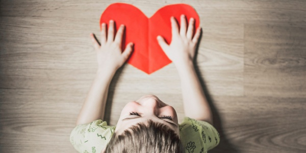 Child with a paper heart